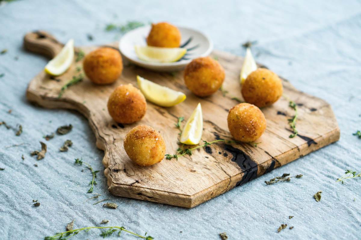 Arrancini balls on chopping board