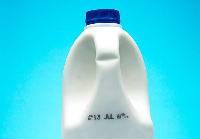 Check the use by date - milk bottle